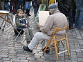 Street artist on the Place du Tertre, Montmartre, February 2007 002.jpg