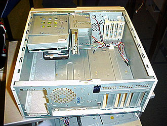 Computer case - An ATX desktop case lying on its side, the rear closest to the camera. The motherboard will lie flat on the bottom, (which would be the right panel with the case upright). Peripheral connectors will protrude through the rear panel, drive bays at the top and front, and the power supply at the top and rear.