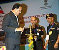 Subhash Ramrao Bhamre lighting the lamp at the inaugural ceremony of two-day seminar on 'Challenges in Planning, Investigation, Design and Construction of Highway Tunnels in Himalayan Region'.jpg