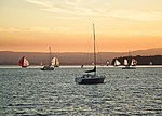 Sunset over sailboats (5406267893).jpg