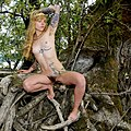 Tattooed blonde in tree.jpg