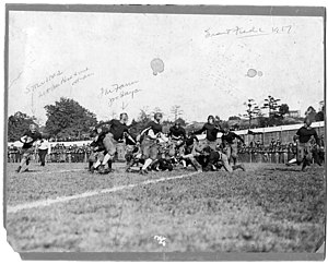 Everett Strupper - Strupper (far left, with ball) rushing v. Penn.