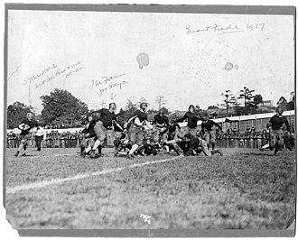 Everett Strupper - Strupper (far left, with ball) rushing v. Penn.