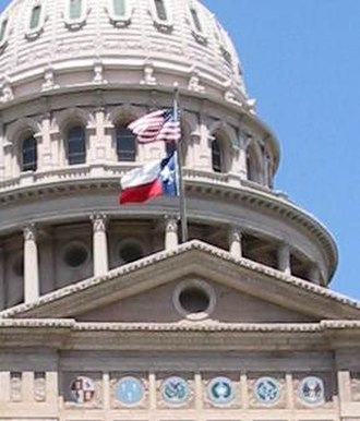 Flag of Texas - The Texas flag flying below the US flag at the Texas State Capitol