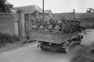 Border Regiment - Men of the 4th Battalion, Border Regiment travel in the back of a lorry, France, May 1940.