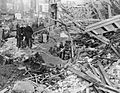 The Current Is Carried On- Electricity Repair work in London, England, 1940 D1475.jpg