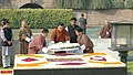 The King of Bhutan, HM Jigme Khesar Namgyel Wangchuck laying wreath at the Samadhi of Mahatma Gandhi, at Rajghat, in Delhi on December 22, 2009.jpg