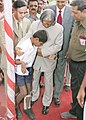 The President Dr APJ Abdul Kalam meeting physically challenged children during his visit to village Loni in Maharashtra on October 15 2005.jpg