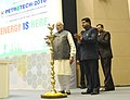 The Prime Minister, Shri Narendra Modi lighting the lamp at the PETROTECH-2016 12th International Oil & Gas Conference and Exhibition, in New Delhi.jpg