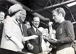 The Queen presents the 1966 World Cup to England Captain, Bobby Moore. (7936243534).jpg