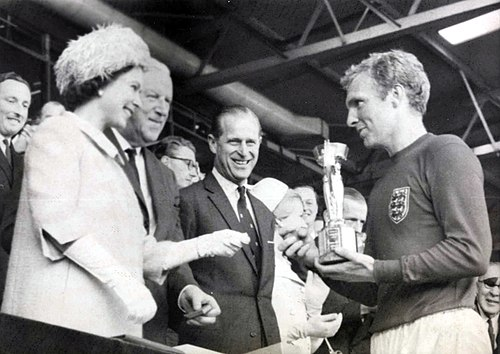 The queen presents the 1966 world cup to england captain, bobby moore. (7936243534)