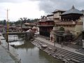 The holy river and the platforms for the cremation pyres, Nepal, Kathmandu.jpg