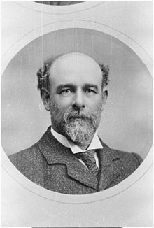 Portrait photo of Thomas Henry Davey, showing him with a bald head and a full beard