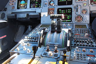 Autothrottle - Thrust levers of an A320 set to the autothrottle position during cruise flight