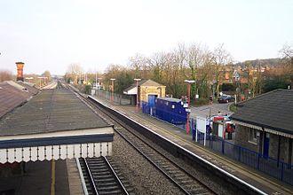 Tilehurst railway station - Fast line platforms and station entrance.
