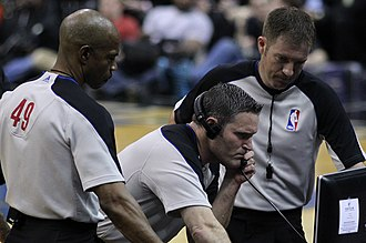 Instant replay - NBA referees reviewing a play