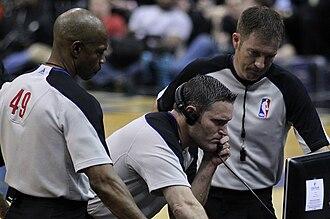 Official (basketball) - Image: Tom Washington, Monty Mc Cutchen, Brent Barnaky on March 30, 2011