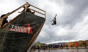 Tough Mudder - A participant completes the Walk the Plank obstacle at the SoCal 2013 Tough Mudder event.