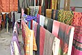 Traditional Laotian garments laid out to dry after dyeing (14418521759).jpg
