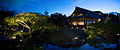 Traditional japanese pavilion exterior placed in a garden surounded with a pond. Kyoto.jpg