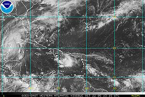 Tropical Storm Alpha (2005) - Hurricane Wilma (left) and Tropical Depression 25 (right) on October 22