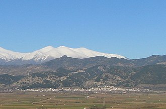 Tsaritsani - A view of Tsaritsani with Mt. Olympus in the background.
