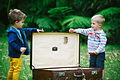 Two boys with a suitcase.jpg