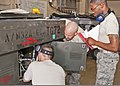 U.S. Air Force Senior Airmen Alfred Fyvie, Joshua Ruberg and Mister Braxton, all with the 361st Training Squadron, check wiring to troubleshoot an electrical problem June 8, 2011, at Sheppard Air Force Base in 110608-F-NS900-033.jpg