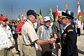 U.S. Army Gen. Walter L. Sharp, right, commander, of United Nations Command, Combined Forces Command and U.S. Forces Korea, expresses thanks to Korean War veterans, during ceremonies, marking the 60th 100915-D-ZZ529-003.jpg