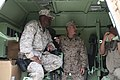 U.S. Marine Corps Sgt. Maj. Bryan B. Battaglia, center, the senior enlisted adviser to the chairman of the Joint Chiefs of Staff, and Master Gunnery Sgt. Reginal Jones, left, with NATO Training 130507-A-CL397-147.jpg