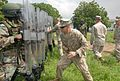 U.S. Marine Corps Sgt. Seth Southerland, center, a military policeman with Bravo Company, 4th Law Enforcement Battalion, shows members of the Ghana Army 2nd Engineer Battalion how to use riot shields during 130620-A-ZZ999-058.jpg