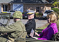 "U.S. Marine Lt. Gen. Richard P. Mills, commander of Marine Forces Reserve and Marine Forces North, rides in a World War II ""Willie"" vehicle during the Veterans Day parade on highway 61 in La Place, La., on 131111-M-IJ438-073.jpg"