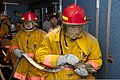 U.S. Navy Able Body Seaman John Wahl, right, and Mario Moralita, a qualified member of the engineering department, practice approaching the galley to put out a simulated fire during an emergency fire drill 120709-F-GA223-004.jpg