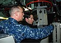 U.S. Navy Cmdr. Steven Wilkinson, left, the commanding officer of submarine USS Hartford (SSN 768), explains to Jerry Trainor, who portrays Spencer Shay on Nickelodeon's TV show iCarly, how to use the periscope 120111-N-AW342-063.jpg