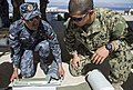 U.S. Navy Explosive Ordnance Disposal Technician 2nd Class Kevin Stoneback, right, assigned to Commander, Task Group 56 130611-N-BJ254-074.jpg
