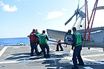U.S. Sailors extend the tail of an MH-60R Seahawk helicopter attached to Helicopter Maritime Strike Squadron (HSM) 70 on the flight deck of the guided missile destroyer USS Truxtun (DDG 103) in the Atlantic 130807-N-YZ751-033.jpg