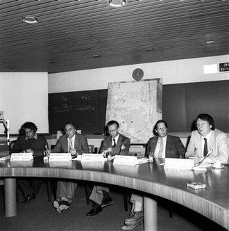 Super Proton–Antiproton Synchrotron - Press conference on 25 January 1983 when the announcement was made of the discovery of the W boson at CERN. From right to left: Carlo Rubbia, spokesperson of the UA1 experiment; Simon van der Meer, responsible for developing the stochastic cooling technique; Herwig Schopper, Director-General of CERN; Erwin Gabathuler, Research Director at CERN, and Pierre Darriulat, spokesperson of the UA2 experiment.