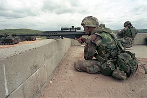 Interceptor Body Armor - A U.S. Marine wearing an IBA vest while practicing with an M82A1 sniper rifle at Camp Pendleton, California in April 2001.