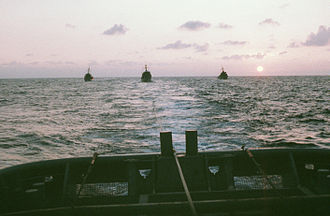 USS Inflict (AM-456) - USS Grapple tows USS Inflict, USS Fearless and USS Illusive.