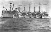 USS Whitney (AD-4) at anchor with USS Stewart (DD-224), USS Pope (DD-225), USS Pillsbury (DD-227), USS John D. Ford (DD-228), USS Truxtun (DD-229) and USS Peary (DD-226), in the 1930s