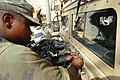 US Army 51269 CAMP LIBERTY, Iraq - Spc. Edric Ashley, a light-wheel vehicle mechanic, from Houston, assigned to quality control and assurance, Division Special Troops Battalion, 1st Cavalry Division, demonstrates w.jpg