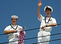US Navy 021002-N-3228G-006 Sailors wave to family members and friends on the pier upon their return to Hawaii aboard USS Hopper (DDG 70).jpg
