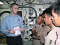 US Navy 030608-N-3160B-002 Damage Controlman 2nd Class Nathan Snyder shows Royal Thai Navy members an emergency water activated repair patch (EWARP) during a familiarization tour of the amphibious dock landing ship USS Harpers.jpg