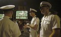 US Navy 030904-N-9693M-001 U.S. Naval Academy Midshipmen Andrew Bankston, left, Gerry Sharp, middle, and Tim Kinkaid, watch the opening plays of the NFL season opener.jpg