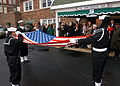 US Navy 040221-N-2899A-001 Sailors assigned to the Naval Station Great Lakes Funeral Detail fold the National Ensign in honor of William Sylvester White.jpg