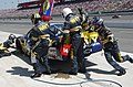 US Navy 040501-N-5362A-121 Members of the Navy sponsored NASCAR racing team pit crew, service the number 14 Chevy Monte Carlo.jpg