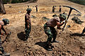 US Navy 040824-N-9712C-002 Seabees assigned to Naval Mobile Construction Battalion Four Zero (NMCB-40) dig fighting positions.jpg
