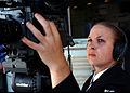 US Navy 041202-N-7130B-023 Photographer's Mate 3rd Class Stefanie Broughton of Oceanside, Calif., adjusts her video camera prior to recording a burial at sea held aboard the Nimitz-class aircraft carrier USS Ronald Reagan (CVN.jpg