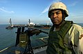 US Navy 041210-N-6932B-030 Boatswain's Mate 1st Class Edward J. Barginere assigned to Mobile Security Force Detachment Two Two (MSD-22), stands security watch on the helicopter platform aboard Iraq's Khawr Al Amaya.jpg