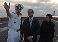 US Navy 050504-N-5248R-001 Capt. Turk Green explains the dynamics of the nuclear-powered aircraft carrier USS Theodore Roosevelt (CVN 71) to Spain's Minister of Defense Jose Bono Martinez.jpg